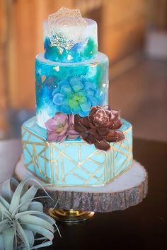 Stunning blue and turquoise wedding cake with gold pattern | Modern Geometric Wedding Inspiration via @bohowedandlife, pics by Denise Karis Photography