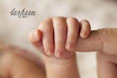 newborn holding finger