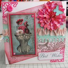 Vintage corset card  Made for Cardmakers Delight as a sample  Ornate corners are using a Cuttlebug die Paper flower made using die cuts from My Craft Studio Paper Flower Expert Ribbon is actually seambinding butterfly die cut on Silhouette Cameo Swirly DP at the back - made by me, using an ornate swirly stamp by Anna Griffin  This is one of my favourite cards...