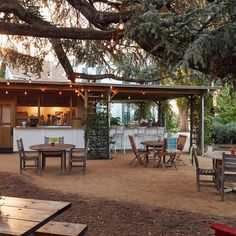 Farmstead at Long Meadow Ranch St. Helena, California tree ground outdoor property chair house backyard home cottage outdoor structure real estate Villa Resort farmhouse Courtyard hacienda log cabin yard Patio restaurant furniture several