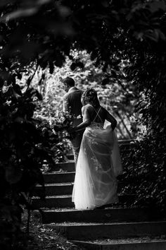 Black and white picture of bride and groom walking up stairs at Stephens House & Gardens wedding London