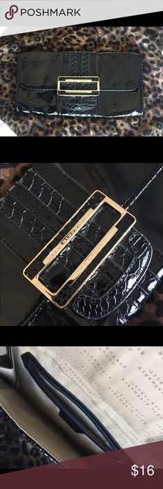 Black patent clutch with gold hardware 👠 Black patent clutch bag with gold hardware great for evening out. Measures 10 1/2in by 5 inches. Completely clean on inside, no peeling. Small indentations across top front as seen in last photo. Anya Hindmarch for Target. Anya Hindmarch for Target Bags Clutches & Wristlets