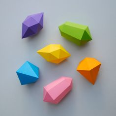 "Paper gems (+ templates) --- This project is quite fiddly so more aimed at grown-ups or older kids. ""You can use these paper gems as hanging decorations (for your Christmas tree) or you can incorporate them into a mobile or garland. I would love to make about a hundred and string them up in front of my window…however there is a limit to my patience!!"""