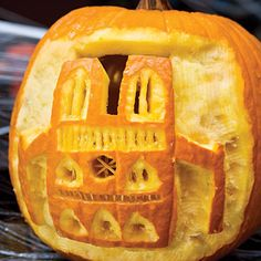 Postcard-Worthy Pumpkin - 33 Halloween Pumpkin Carving Ideas - Southern Living