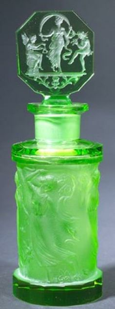 A Czechoslovakian Hoffman perfume bottle, circa 1920s, in clear and frosted green crystal.