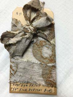 Rust dyed dupioni silk bias ribbon