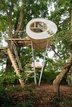 Here's another modern treehouse design from the great guys at baumraum. This unique structure features a shape of an egg – both inside and out; it's located in a wooded area near Bremen, Germany, serving as the owners' comfortable tree house – A nest for the whole family.