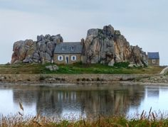 The famous stonehouse situated between two rocks at Castel Meur, Pointe du Château, Plourgrescant, Bretagne, France. Photo by Candy