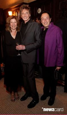 Adrienne Anderson, singer-songwriter Barry Manilow, and Marty Panzer pose at Mon Ami Gabi French Bistro at the Paris Las Vegas on March 27, 2010 in Las Vegas, Nevada.