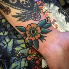 american traditional flower tattoo wrist \ american traditional tattoo wrist + american traditional tattoo wrist band + american traditional wrist cuff tattoo + american traditional flower tattoo wrist + american traditional wrist tattoo old school Tattoo Life, Tattoo You, Arm Tattoo, Body Art Tattoos, Sleeve Tattoos, Cool Tattoos, Cuff Tattoo, Tatoos, Traditional Tattoo Flowers