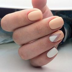 This cute two-colored manicure is made in white and peach. The main accent is made on the ring finger where