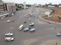 STRANGE INTERNATIONAL TRAFFIC SITUATION - HUGE UNCONTROLLED CROSSROADS WITH OVER 25 LANES OF TRAFFIC CONVERGING! - WHAT A MESS - CRAZY ACTION GIF!