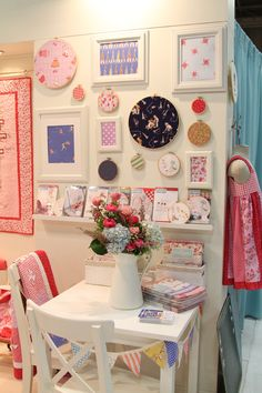 This is a booth display but I love the hoop/frame/shelf arrangement for a kids room