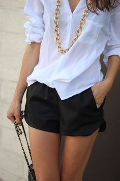 Fashion trends | White blouse, black shorts, gold necklace