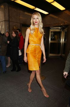 Karolina Kurkova's crimson lips really popped thanks to her tangerine dress