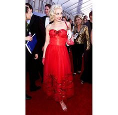 We see a starlet in the making! Although this look (for the 2001 Grammys) is more glamorous than her previous red carpet ensembles, Gwen's structured, ankle-length red dress could have down without the sheer red gloves, fishnet stockings and too-casual white bag. #gwen #celebritystyle #reddress