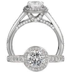 Classic engagement ring featuring a round halo with a prong set round cut centerstone surrounded with the finest set micropavé diamonds with a diamond undergallery and a graduated diamond shank.