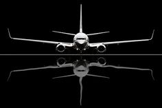 737 Boeing Business Jet BBJ, reflecting in a puddle