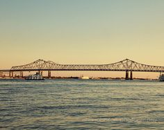 new orleans photography mississippi river sunset greater new orleans bridge boat photograph blue home decor orange decor On the Riverwalk by eireanneilis
