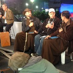 The Friars and Doug Barry all wear light jackets for this chilly evening interview underneath the stars of Rio.