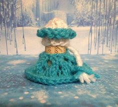Let it go, let it go~ a perfect addition to your wine collection! This wine cork is accessorized with Elsa's knitted blue dress and topped with her white hat, blue tiara and of course, her long white braid that is accented with a little blue bow.  Elsa stands 2.5 inches tall. The wine cork is included.  #coupon #Frozen #elsa #wine #cork