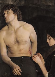 Jamie & Claire,claire stiching up jamie after he was wounded- Outlander
