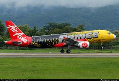 AirAsia (MY) Airbus A320-216 9M-AHL aircraft, painted ay ''Prince Lubricants'' special colours Apr. 2014 - Dec. 2016, landing at Thailand Chiang Mai International Airport. 31/08/2014.
