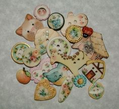Porcelain Buttons at Gold Seal Products Animals, plants, dolls, etc. Incredible buttons.
