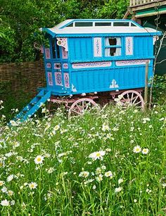 Blue and pink gypsy caravan..I would love to have a garden big enough for one of these