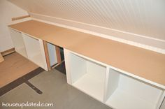 built-in ikea besta shelving units with counter.         FOR CLOSET IN OFFICE AREA.
