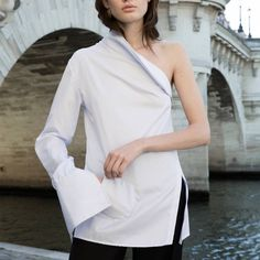 Deconstructed, asymmetrical, and oversized. The classicwhite button-down shirt will never be the same after designers, like Monse, Joseph and Jacquemus, have so cleverly reimagined the crispwardrobe staple in their 2016 collections. Currently on my radar are Anna Quan's cotton twill shirts with