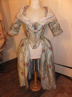 robe a l'Anglaise lifted à la polonaise of Spitalfields silk This lovely circa 1765-70 gown, with it's stunning pale green & ivory changeable silk, was altered in the 19th Century