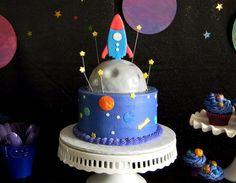 My baby recently had a birthday. Since he's 6 now, I probably should stop referring to him as my baby, but I can't! He's my only child and . Themed Birthday Cakes, Themed Cakes, 5th Birthday, Birthday Ideas, Solar System Cake, Rocket Birthday Parties, Space Cupcakes, Rocket Cake, Planet Cake