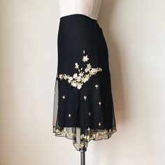 """ANTHROPOLOGIE   Embroidered Floral Tulle Skirt FEATURES:  *Side invisible zipper  *Front & rear asymmetric split  *Fully lined  *Beautiful embroidered floral detail throughout  *Knee length  *100% nylon  MEASUREMENTS: Waist - 31"""" Hips - 39"""" Length - 27 1/2""""  ✅ Excellent condition ⛔️ NO SWAPS/TRADES/RESERVES Anthropologie Skirts"""