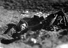 German machine-gun nest and dead gunner at Villers Devy Dun Sassey, France, on  November 4, 1918 – one week before the end of the war.
