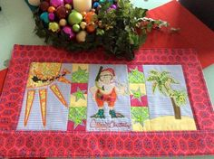 Machine embroidery design for a patchwork table runner featuring a Summer Santa design. Has 4 different blocks made in the 5x7, 6x10, and 8x12 hoop sizes.