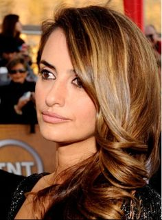 Love the color of those highlights.  It's a new process called Balyage. Nice and subtle. Perfection on dark hair!