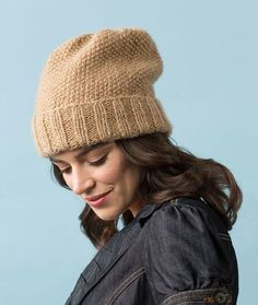 Seed Stitch Slouchy Hat Free Knitting Pattern in Red Heart Boutique Gleam yarn -- Gorgeous yarn with an uneven metallic wrap gives this basic hat out-of-the-ordinary panache! The Seed stitch pattern and deep ribbed banding are comfortable to wear.