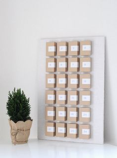 This a charm and Very Cool Factory with this design.  I personally would add the simplest of pine needles and maroon numbers.  I like this  Pin. | Minimalist craft box advent calendar