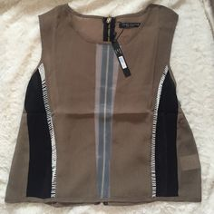 Detailed Crop Sheer down the middle. Lightweight. Zipper up the back. White stitching and black sheer stripes. Olive greenish/ brownish color. Tops Crop Tops