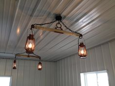 Lighting in our garage recreation room using electrified barn lanterns, yokes and single trees.