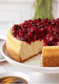 Cranberry-Glazed Cinnamon Cheesecake — Nothing rings in the season more deliciously than this showstopper party dessert recipe made with sour cream for smoothness and rich flavor.