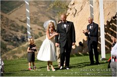 The recessional! Retro 1950s inspired wedding ceremony at Louland Falls, Utah.  Black, white and red wedding colors. Bride wears a sweet tea length retro wedding dress.