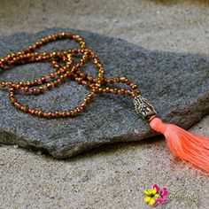 """Stay upbeat wear our """"Happiness Mala Necklace"""" for only $41. Enter """"FREESHIPPING"""" for orders $25 and above when you checkout from our online store!# #MalaNecklace #Jewelry #NewTrends #Beads #GoldBuddha #Orange #Buddha #TassleNecklace #Tassle #Necklace #HippieStyle #MeditationNecklace #Happiness Necklace #Gypsy #Boho #Peace #Love #Happiness #Luvgypsy #Bohemian #Mantras #StatementJewelry #Jewelry #BohoChic #Bohemian #BohemianJewelry #GypsyNecklace #NiceJewelry #HippieNecklace"""