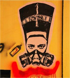 Nefertiti (wife of Egyptian pharaoh Akhenaten) wears a gas mask as a symbol of women's involvement in the revolution, stenciled by El Zeft.  Read more: Feminist Street Art of Cairo | Scoop Empire http://scoopempire.com/feminist-street-art-cairo/#ixzz2scAUnbZO  Follow us: @Stephanie Ng Canavan Empire on Twitter | ScoopEmpire on Facebook