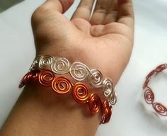 Get your swirl on with this Endless Swirl Wire Bracelet.