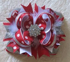 Red and Silver Christmas Hairbow on Etsy, $9.00 but can easily be a DIY project
