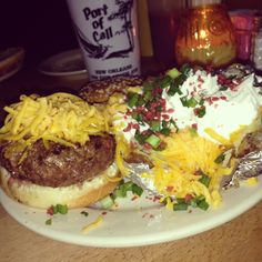 Delicious cheese burger with a loaded baked potato at Port of Call in #NOLA!