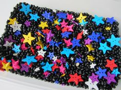 Star Sorting and Sensory Bin - children could sort by color, size if you have different size stars, shape if you choose to include other shapes. From No Time for Flash Cards. I would love to include some boon doggle for threading! Space Preschool, Space Activities, Sensory Activities, Preschool Activities, Preschool Shapes, Preschool Colors, Sensory Tubs, Sensory Boxes, Sensory Play
