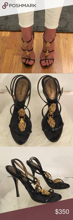 ROBERTO CAVALLI BLACK SANDALS SIZE 37.5 Strappy high heel sandals with gold lion heads. Incredible shoes.   (I am also selling the majority of my closet so make sure to check out all of my posts.) Roberto Cavalli Shoes Heels